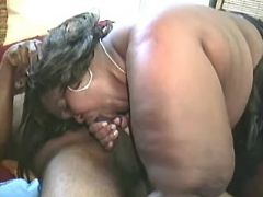 Mega fat ebony sucking black cock