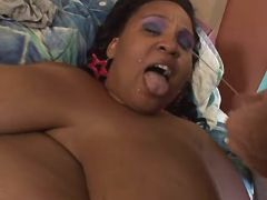 Large ebony bitch gets cum on tits