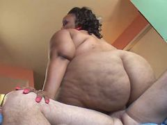 Chubby ebony whore jumps hard cock