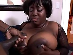 Fat ebony whore gets cum om massive tits